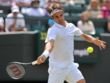 Switzerland's Roger Federer returns against Spain's Tommy Robredo during their men's singles fourth round match on day eight of the 2014 Wimbledon Championships at The All England Tennis Club in Wimbledon, southwest London, on July 1, 2014