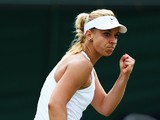 Sabine Lisicki of Germany celebrates during her Ladies' Singles fourth round match against Yaroslava Shvedova of Kazakhstan on day eight of the Wimbledon Lawn Tennis Championships at the All England Lawn Tennis and Croquet Club on July 1, 2014