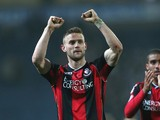 Simon Francis of Bournemouth celebrates their victory to the fans at the final whistle during the Sky Bet Championship match between Blackburn Rovers and Bournemouth at Ewood Park on March 12, 2014