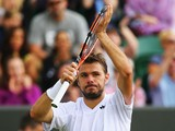 Stan Wawrinka of Switzerland celebrates after winning his Gentlemen's Singles third round match against Denis Istomin of Uzbekistan on day seven of the Wimbledon Lawn Tennis Championships at the All England Lawn Tennis and Croquet Club on June 30, 2014