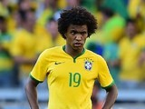 Brazil's Willian watches the penalty shootout between his side and Chile on June 28, 2014