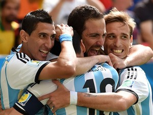 Argentina striker Gonzalo Higuain celebrates with teammates Angel Di Maria, Lionel Messi and Lucas Biglia after scoring the opening goal against Belgium in the 2014 World Cup quarter-final in Brasilia on July 5, 2014