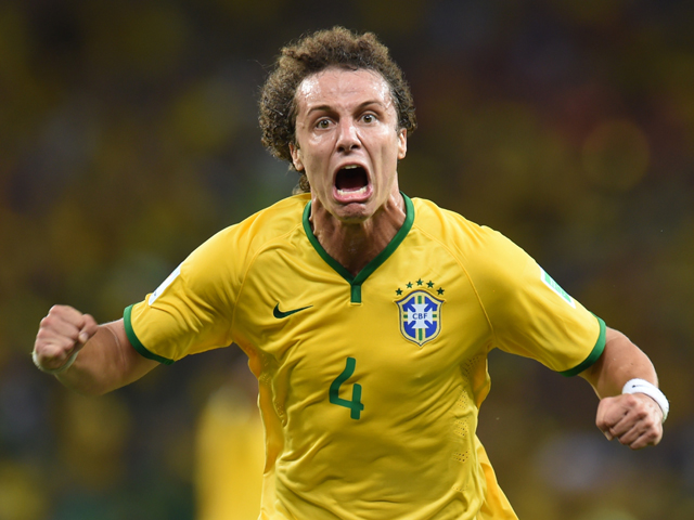 Brazil's defender David Luiz celebrates scoring during the quarter-final football match between Brazil and Colombia at the Castelao Stadium in Fortaleza during the 2014 FIFA World Cup on July 4, 2014
