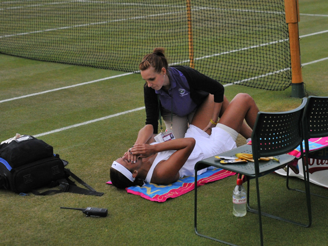 US player Madison Keys receives a medical time out during her women's singles third round match against Kazakhstan's Yaroslava Shvedova on day six of the 2014 Wimbledon Championships at The All England Tennis Club in Wimbledon, southwest London, on June 2