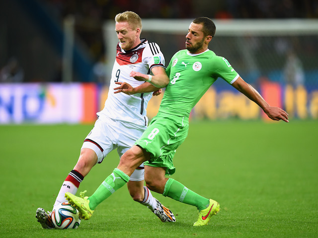 Medhi Lacen of Algeria challenges Andre Schuerrle of Germany during the 2014 FIFA World Cup on June 30, 2014