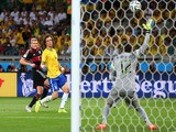 Andre Schuerrle of Germany scores his team's seventh goal past Julio Cesar of Brazil during the 2014 FIFA World Cup Brazil Semi Final match on July 8, 2014