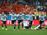 Lionel Messi, Pablo Zabaleta, Martin Demichelis, Marcos Rojo, Lucas Biglia, Javier Mascherano, Rodrigo Palacio and Ezequiel Garay of Argentina celebrate defeating the Netherlands in a shootout during the 2014 FIFA World Cup Brazil Semi Final match between