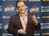 Team owner Dan Gilbert of the Cleveland Cavaliers talks to the media prior to the game against the Brooklyn Nets at Quicken Loans Arena on October 30, 2013