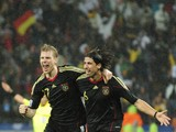 Germany's midfielder Sami Khedira (R) and Germany's defender Per Mertesacker celebrate after Khedira scored a goal during the third place World Cup 2010 football match Uruguay versus Germany on July 10, 2010