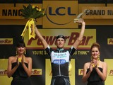 Matteo Trentin of Italy and the Omega Pharma - Quick-Step Cycling Team celebrates on the podium after winning stage seven of the 2014 Le Tour de France from Epernay to Nancy on July 11, 2014