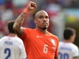 Netherlands' midfielder Nigel de Jong celebrates their victory at the end of a Group B football match against C