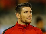 Sebastien Pocognoli of Belgium stands for the national anthem prior to the FIFA 2014 World Cup Qualifying Group A match against Wales on October 15, 2013