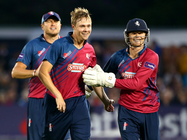 Fabian Cowdrey of Kent celebrates with Sam Billings after taking the wicket of Matthew Machan of Sussex during the Natwest T20 Blast match between Sussex Sharks and Kent Spitfires at TheBrightonAndHoveJobs.com County Ground on July 11, 2014