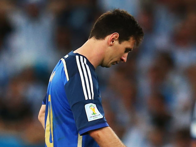 Lionel Messi of Argentina (R) looks dejected after a goal