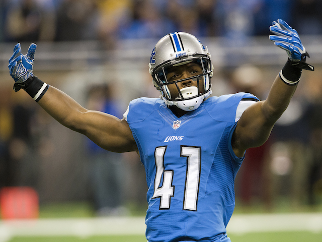 Running back Theo Riddick of the Detroit Lions tries to rev up the crown prior to kick off against the Baltimore Ravens on December 16, 2013