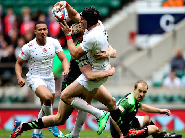 Tom Powell of England is tackled during the Marriot London Sevens match between England and Wales at Twickenham Stadium on May 10, 2014 in London, England