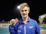 Jack Laugher holding his bronze medal at the diving World Cup on July 19, 2014