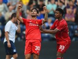 Suso of Liverpool celebrates scoring with team mate Jordan Ibe during the pre season friendly match between Preston North End and Liverpool at Deepdale on July 19, 2014