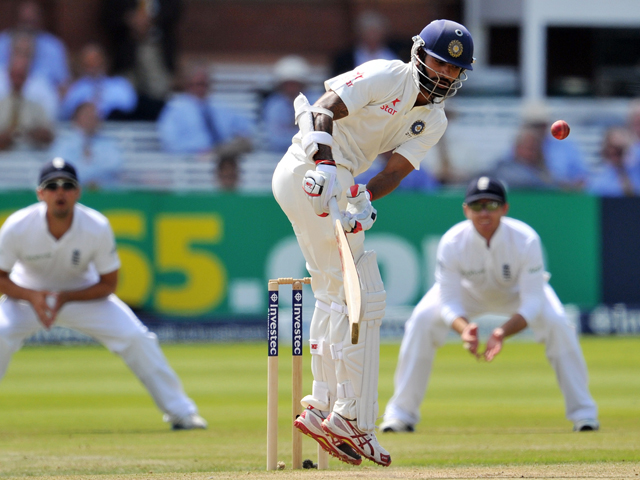 India's Shikhar Dhawan fails to avoid a bowl from England's Ben Stokes during the third day of the second Test cricket match between England and India, at Lord's Cricket Ground in London, England on July 19, 2014