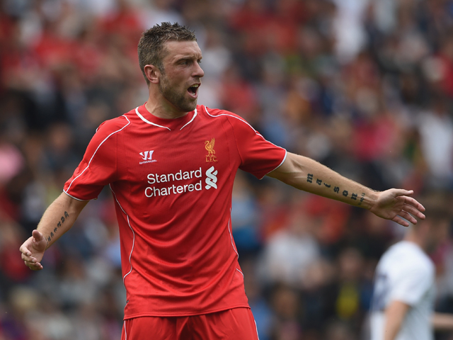 Rickie Lambert of Liverpool gestures during the pre season friendly match between Preston North End and Liverpool at Deepdale on July 19, 2014