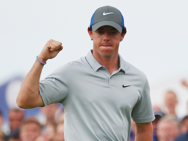 Rory McIlroy of Northern Ireland celebrates holing an eagle putt on the 16th green during the third round of The 143rd Open Championship at Royal Liverpool on July 19, 2014