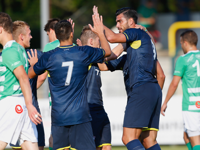 Graziano Pelle of Southampton celebrates with teammates after scoring his first goal during the pre-season friendly match between KSK Hasselt and Southampton at the Stedelijk Sportstadion on July 17, 2014
