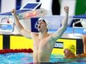 Dan Wallace celebrates winning gold for Scotland in the 400m individual medley on July 25, 2014