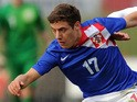 Nikola Vlasic of Croatia battles for the ball during the U18 International friendly match against England on March 5, 2014