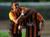 Ahmed Elmohamady of Hull City congratulates his team-mate Robbie Brady after he scored a goal during a pre-season friendly against Harrogate Town on July 21, 2014