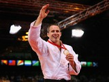 Gold medalist Euan Burton of Scotland on the podium during the medal ceremony for the Men's -100kg Judo final at the Scottish Exhibition and Conference Centre Precinct during day three of the Glasgow 2014 Commonwealth Games on July 26, 2014