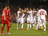 Roma's Marco Borriello reacts after scoring in the 90th minute during a friendly soccer match between Liverpool and Roma at Fenway Park, July 23, 2014