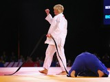 Sarah Adlington of Scotland celebrates victory over Jodie Myers of England in the Women's +78kg Judo gold medal final at the Scottish Exhibition and Conference Centre Precinct during day three of the Glasgow 2014 Commonwealth Games on July 26, 2014