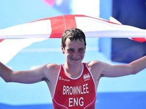 England's Alistair Brownlee celebrates winning the gold in the men's triathlon