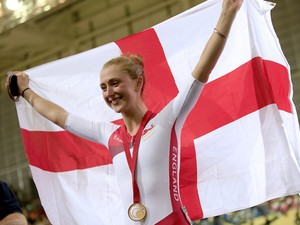 England's Laura Trott poses on the podium after winning the gold medal in the women's 25km points race cycling event in the Sir Chris Hoy Velodrome during the 2014 Commonwealth Games in Glasgow, Scotland on July 27, 2014