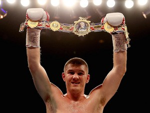 Liam Smith celebrates his victory over Mark Thompson during their Light Middleweight bout at Liverpool Echo Arena on December 7, 2013