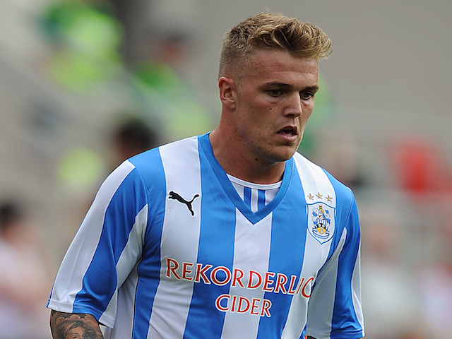 Danny Ward of Huddersfield Town in action during the pre season friendly match between Rotherham United and Huddersfield Town at The New York Stadium on July 20, 2013