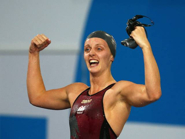 Francesca Halsall celebrates winning gold for England in the women's 50m freestyle on July 26, 2014