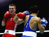 Ashley Williams competes against Devendro Liashram of India during the Men's Light Fly 46-49kg Semi-Finals Boxing at Scottish Exhibition And Conference Centre during day nine of the Glasgow 2014 Commonwealth Games on August 1, 2014