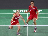 Gabrielle Adcock of England sets to play a backhand while playing with her partner Chris Adcock of England as they compete in their mixed doubles badminton quarter-final match at Emirates Arena during day nine of the Glasgow 2014 Commonwealth Games on Aug