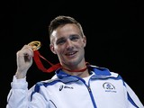 Scotland's Josh Taylor poses on the podium after winning the gold medal in the men's light welter (64kg) final boxing bout at the 2014 Commonwealth Games in Glasgow, Scotland, on August 2, 2014