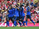 Radamel Falcao of Monaco celebrates scoring the first goal with team mates during the Emirates Cup match between Arsenal and AS Monaco at the Emirates Stadium on August 3, 2014