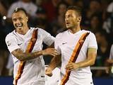 Francesco Totti #10 of AS Roma celebrates a goal with Radja Nainggolan #4 against Real Madri