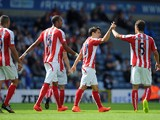 Bojan Krkic of Stoke City is congratulated by team-mate Marc Muniesa after scoring the equaliser during the pre season friendly match between Blackburn Rovers and Stoke City at Ewood Park on August 03, 2014