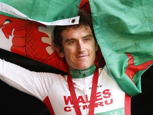 Gold medallist Wales' Geraint Thomas poses on the podium during the Men's cycling road race medal ceremony during the 2014 Commonwealth Games in Glasgow, Scotland on August 3, 2014