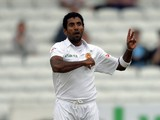 Sri Lanka's Dhammika Prasad celebrates dismissing England's Matt Prior during the fifth and final days play in the second Test cricket match between England and Sri Lanka at Headingley in Leeds, England on June 24, 2014