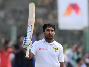 Sri Lankan cricketer Kumar Sangakkara celebrates reaching a century (100 runs) during the third day of the opening Test match between Sri Lanka and Pakistan at the Galle International Cricket Stadium in Galle on August 8, 2014