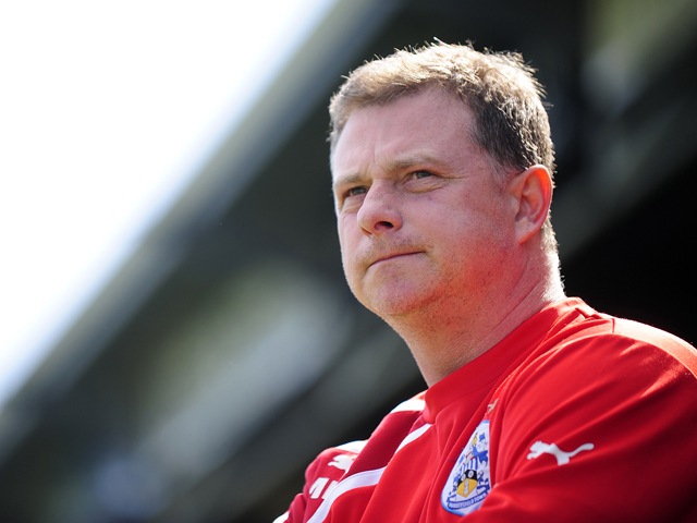 Mark Robins, Manager of Huddersfield Town looks on during the Sky Bet Championship match between Yeovil Town and Huddersfield Town at Huish Park on April 21, 2014
