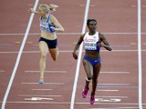 Dina Asher-Smith of Great Britain crosses the finish line ahead of Hanna-Maari Latvala of Finland during the Women's 200 metres semi-final during day three of the 22nd European Athletics Championships at Stadium Letzigrund on August 14, 2014