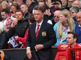 Manchester United Manager Louis van Gaal takes his seat prior to the Barclays Premier League match between Manchester United and Swansea City at Old Trafford on August 16, 2014