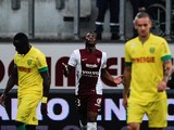 Metz's French forward Yeni Ngbakoto gestures after scoring a goal during the French L1 football match between FC Metz and FC Nantes on August 16, 2014